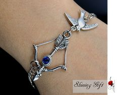 Hunger Games Inspired Bow Mockingjay bracelet by Shininggift, $3.49