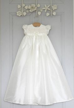 Olivia is a gorgeous ivory silk dupion gown trimmed with a beautiful venice lace and ivory satin ribbon. Available in ivory only. Your Christening gown can be personalised at the bottom of the back skirt with your baby's initials (or name) and the date of the Christening or Baptism or date of birth.The Olivia gown makes a perfect heirloom christening dress. We use only the finest laces and silks available and finish off our gowns with beautiful little handmade buttons and rouleaux loop ...