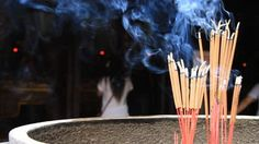 Burning incense at the temple in Hanoi, Vietnam - HD stock video clip