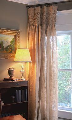Gorgeous, smocked, burlap curtains @Laura Jayson Daniel. An idea for all that burlap you have!!!