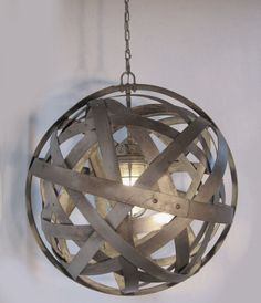 http://www.stilnovodesigns.com/store/p6/Orbits%2C_urban_chandelier%2C_recycled_wine_barrel_metal_hoops%2C_galvanized_steel_bands%2C_ceiling_light_fixture.html