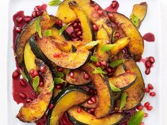 Pomegranate-Glazed Acorn Squash : Slice acorn squash into thin wedges and roast before tossing with pomegranate juice and pomegranate seeds for a colorful fall side dish. Sprinkle with torn mint before serving. <br /> via Food Network Side Dish Recipes, Vegetable Recipes, Vegetarian Recipes, Cooking Recipes, What's Cooking, Fall Dinner Recipes, Thanksgiving Recipes, Fall Recipes, Pear Recipes