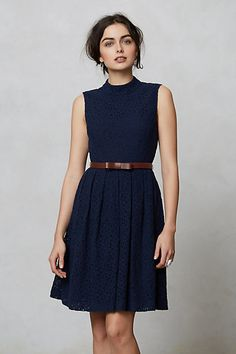 Classic, high collared navy dress