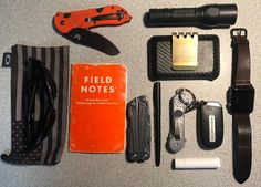 EMT's off duty EDC  submitted by Anthony  Benchmade Triage  SureFire G2X LE  Oakley Flak Jacket  Field Notes Expedition  Leatherman Wingman  Fisher Space Pen  KeyBar  Hellbent Holsters Combat Wallet 2.5 - Black Carbon Fiber - Money Clip Sold Separately (Medium (5-8 Cards) No RFID)  Apple Watch 42mm  TRIMleather Apple Watch leather band