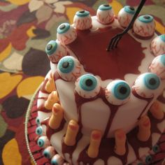 cake for Halloween....cake balls as eyes, thick pretzels sticks tipped in whit chic as fingers