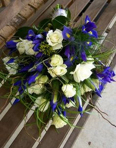 Gorgeous sheaf style bouquet of white roses, Dark blue iris, berries, grasses…
