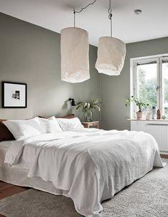Cozy bedroom with a green wall - via Coco Lapine D Grey Green Bedrooms, Green Bedroom Walls, Green Master Bedroom, Bedroom Wall Colors, Cozy Bedroom, Home Decor Bedroom, Design Bedroom, Bedroom Wall Lights, Grey Wall Bedroom