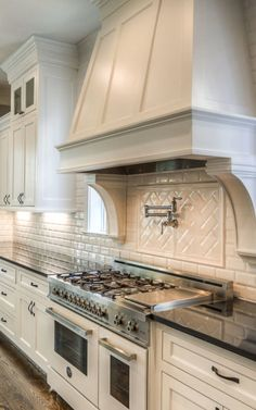 Curved Vent Hood With Corbels And Pot Filler