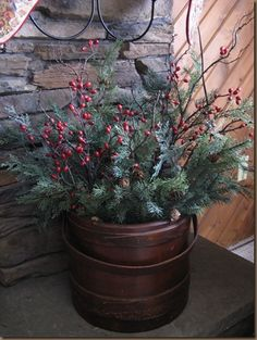 Tuck some greenery & berries in a crock or bucket...such easy decorating for the holidays!