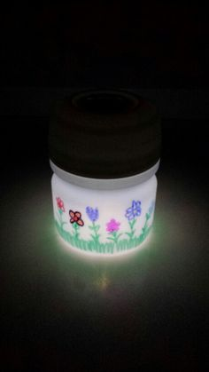 Lemonade mix container solar light.  Cut hole in lid and glue solar light stake inside lid.   Color with markers. Place on window sill.