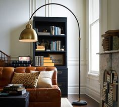 Brass floor lamp for your family room.   Winslow Arc Sectional Floor Lamp | Pottery Barn