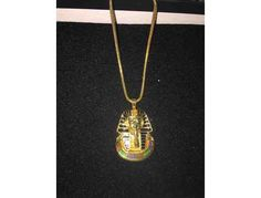 This auction is for a necklace of King Tut's Image. The item is 18