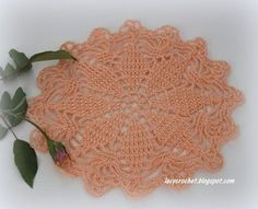 This small doily is actually a vintage tablecloth motif from New Ideas in Crochet, Table Topics, Book No.123 by The Spool...