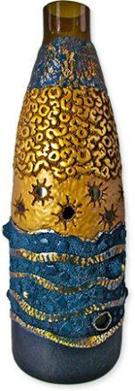 The peek-a-boo quality of Donna Greenberg's polymer covered glass vase catches your eye. Rich colors and patterns with metallic sheen add to the allure. Organic shapes and rough textures replace the flowers and frills we've come to expect on po [...]
