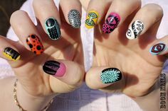Yayoi Kusama inspired nail art. Love the left yellow nail, the left black and white and the right thumb