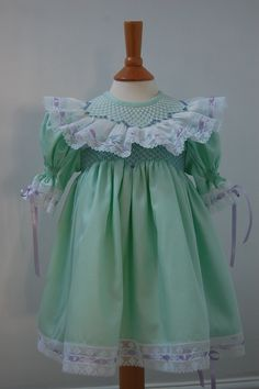 Hand Smocked dress with bishop lace collar