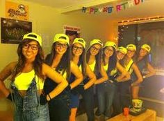 Minion costumes. NO to the sports bra but I like the backwards yellow caps!