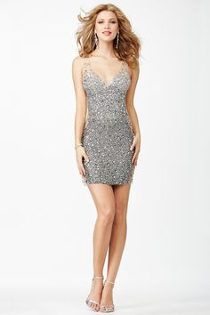 Look like a million dollars in the slinky Jovani JVN27591 crystal embellished mini dress. Silver ombre crystals shimmer spectacularly on sheer mesh in this seductive sleeveless sheath gown. The dress showcases an illusion V-neckline and illusion scoop back. Illusion side panels span the length of the gown, creating an image of bare jeweled flesh.