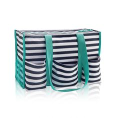 Zip-Top Organizing Utility Tote in Navy Wave for $35 - This versatile tote is one of our top sellers. With seven exterior pockets and a zipper to keep everything safe and secure, it�s the perfect bag to keep you organized on the go. Via @thirtyonegifts