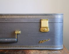 Love this vintage suitcase. This is almost the exact one I have for Eva's dog bed!