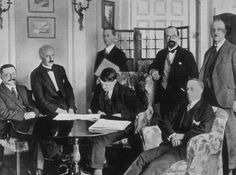 Signing the Anglo-Irish Treaty, 1921. Left to right: Griffith, Duggan, Childers (standing), Collins, Gavan Duffy, Barton and Chartres.