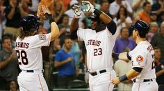 HOUSTON, TX - MAY 16:  Astros go deep to top Blue Jays wins 4th in row - Blue Jays vs Houston Astros 2-4, as Houston Astros WIN. Chris Carter #23 of the Houston Astros (C) is greeted by teammates Colby Rasmus #28 and Preston Tucker #20 after Carter hit a three-run home run in the sixth inning during their game against the Toronto Blue Jays at Minute Maid Park on May 16, 2015 in Houston, Texas.  (Photo by Scott Halleran/Getty Images)