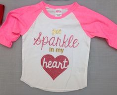 Sparkle heart valentines raglan Got Sparkle in my Heart Neon Pink Raglan, $25.00 use the code PIN for a discount www.sparklebowtique.com