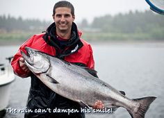 The rain can't dampen his smile! The salmon in Naden Harbour keep biting, despite the drizzle.