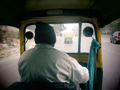commutes in Delhi, India.  Auto