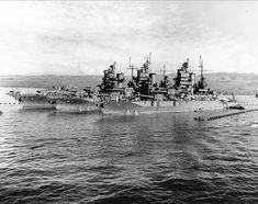 Battleship sisterships USS Idaho, USS New Mexico & USS Mississippi at anchor in the Pacific during World War II.