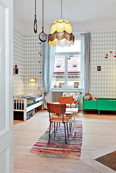 low beds that children can climb out of independently//gross motor via the rings from the ceiling//eclectic but calm