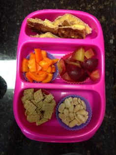 Grilled cheese triangles, sliced plum, fresh orange bell pepper, cinnamon oat squares, dry roasted peanuts