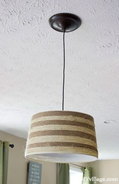 Swap out your light fixture for one that's seasonal. Dust off an old drum shade or pick up an inexpensive one at a discount store. The design doesn't matter, because you'll cover it with sisal rope and jute twine. Get the tutorial from The DIY Village.   - GoodHousekeeping.com