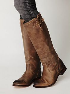 amazing tall brown boots, they look so broken in and comfy... 500 dollars what a steal!