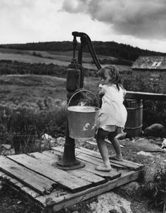 Water pump . My grandma had one of these  it was heavy to transport those buckets full of water.