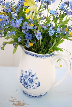 blue and white jug of flowers