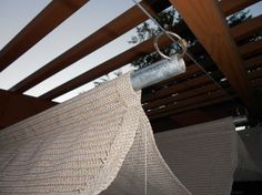 DIY pergola shade..am so going to do this! I think I will drill holes on each end and use I bolts to slide on the wire....maybe garage door cable.