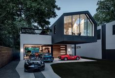 Autohaus is a petrolheads´ dream come true, a car collectors´ garage and residence in central Texas. Designed by the Matt Fajkus Architecture studio, the residence features living quarters on the top floor, floating above a large open garage where th Houses In Austin, Austin Homes, Austin Texas, Texas Usa, Austin Cars, Interior Exterior, Exterior Design, Interior Paint, Design Garage