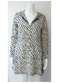 Jaquard Zip Up | Let your wild side show in this animal print cardigan.  Tunic length.  Full zip front.  Hooded back.  72% Cotton/28% Polyester.  Sizes S-XL. | Willy & Babbish Boutique | New Baltimore, MI