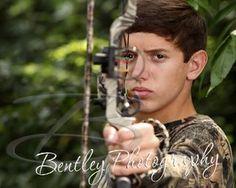 Senior boy, bow and arrow