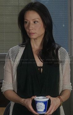 Joan's black draped wrap dress and perforated cardigan on Elementary.  Outfit Details: http://wornontv.net/21633/ #Elementary