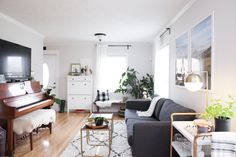 """""""I feel that plants instantly make a home feel like one,"""" writes Dana. """"A fiddle leaf fig and some air plants were the first pieces I bought for our home."""""""