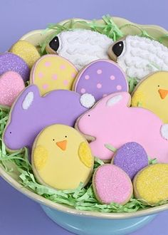 Easter Sugar Cookies - Love the fat little chicks with sanding sugar wings!