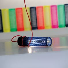 Stefano Giovacchini scavenges textile mills for the plastic cylinders used to dye yarn, then repurposes them as Re+ LED lamps for Mariplast. Available in 11 colors including metallic blue, this versatile lamp can stand, hang, or fl ip at will. It's exceedingly eco, too. The 12-inch-long tube, 3 inches in diameter, is not only recycled but also recyclable, and the 7-watt LED bulb consumes up to 85 percent less energy than halogen equivalents. 39-0573-950230; repiu.it.