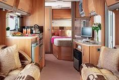 This caravan space shows a how functional a small space can be as is gives an example of living; kitchen and bedroom space combined into one space.