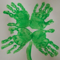 St. Patrick's Day: Four Leaf Clover Hand Print Art - write/draw pics of things the Ss are lucky for!