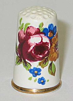 Porcelain thimbles.....red and blue flowers