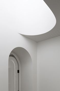 Arched door meets smooth curved stair cutout at Hopetoun Road Residence