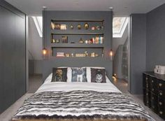 Clever Bedroom Storage Solutions Stylish storage solutions for making the most of a small bedroom such as combining storage styles, using the space under the bed, and utilizing see-through items. Wall Behind Bed, Bed Wall, Bedroom Wall, Bedroom Decor, Bedroom Ideas, Bedroom Lighting, Bedroom Designs, Shelves In Bedroom, Bedroom Storage