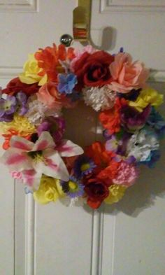 DIY spring flower wreath. Dollar store foam wreath+ dollar store fake flowers and glue = wreath. Just snip them off and poke them into the wreath with some glue to hold in place. Less than $10!